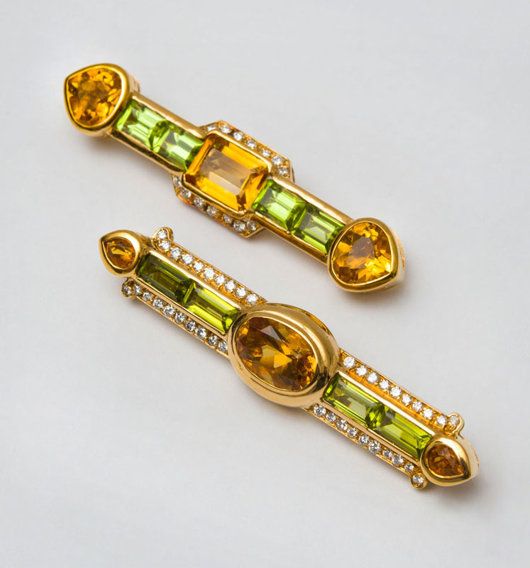 TWO 18K GOLD, CITRINE AND PERIDOT BAR BROOCHES