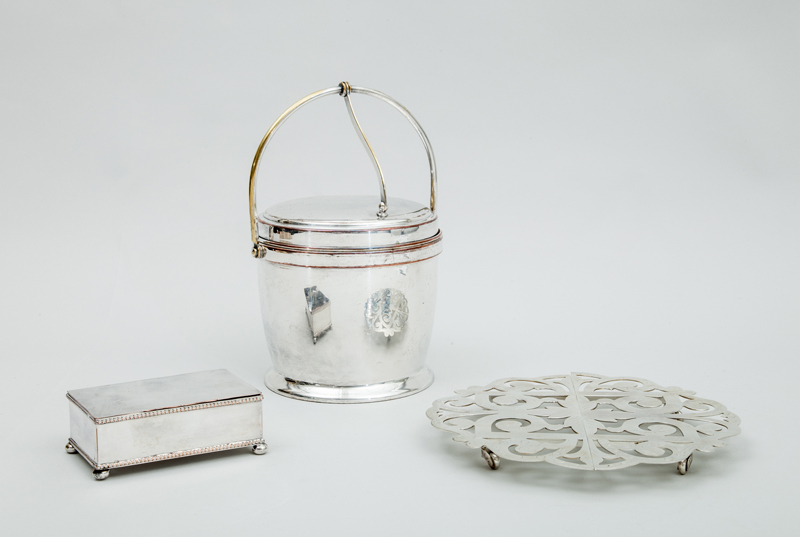 Silver-Plated Ice Bucket with Hinged Lid, a Plated Cigarette Box and an Adjustable Trivet