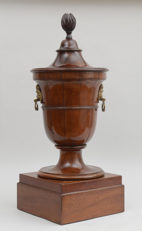 GEORGE III BRASS-MOUNTED CARVED MAHOGANY URN-FORM CELLARETTE AND COVER