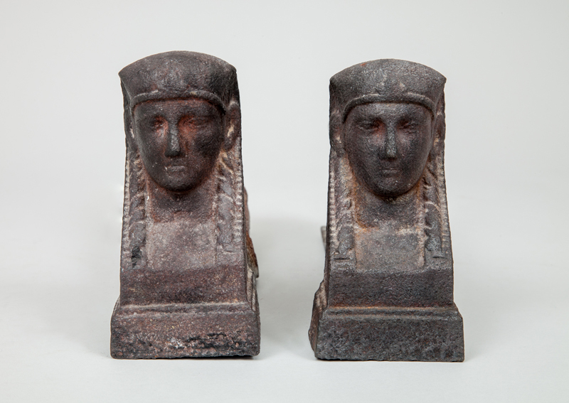 Two Similar Cast-Iron Sphinx-Form Log Rests