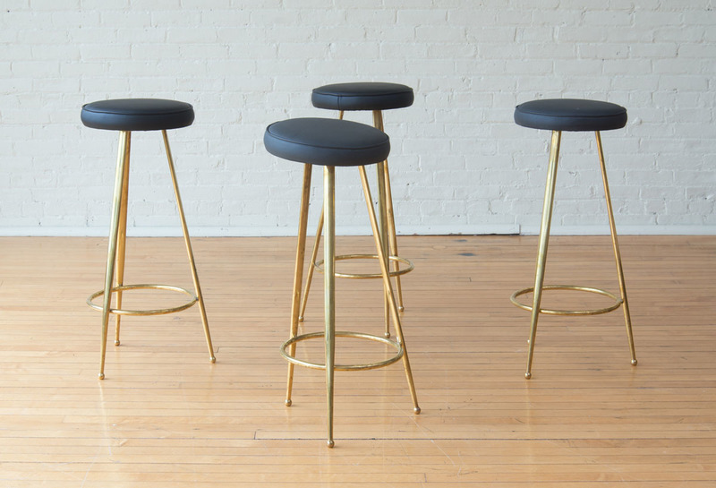 FOUR BRASS AND LEATHER BAR STOOLS