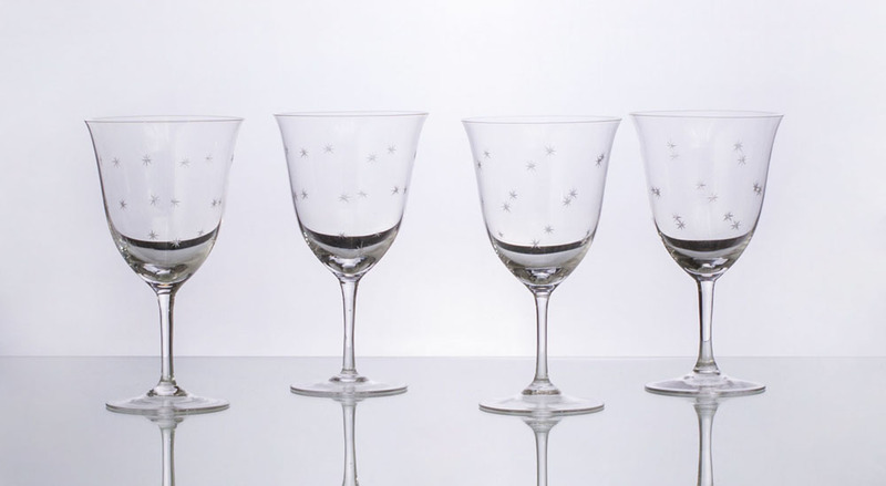 SET OF TEN GLASS WATER GOBLETS ETCHED WITH STARS
