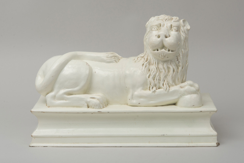 LARGE WHITE GLAZED FIGURE OF A RECUMBENT LION