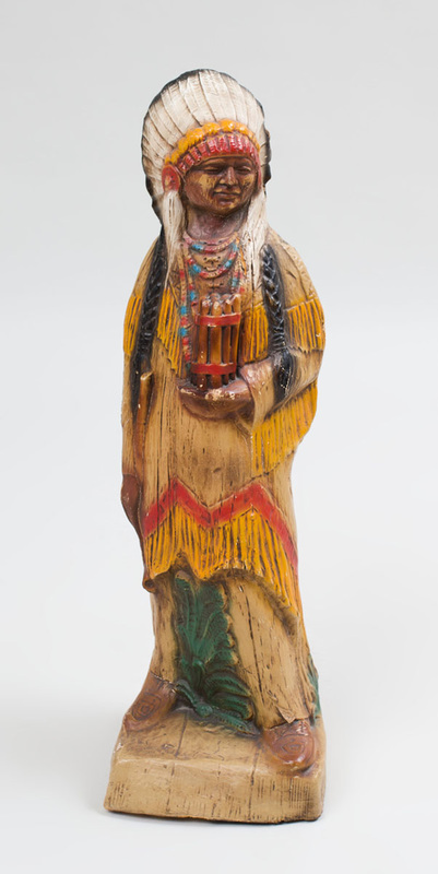 American Painted Hollow-Cast Celluloid Cigar Store Native American Figure Holding a Cigar