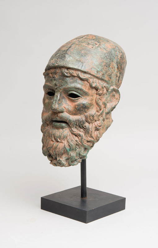 RED-ENCRUSTED-BRONZE HEAD OF A BEARDED WARRIOR, AFTER THE ANTIQUE