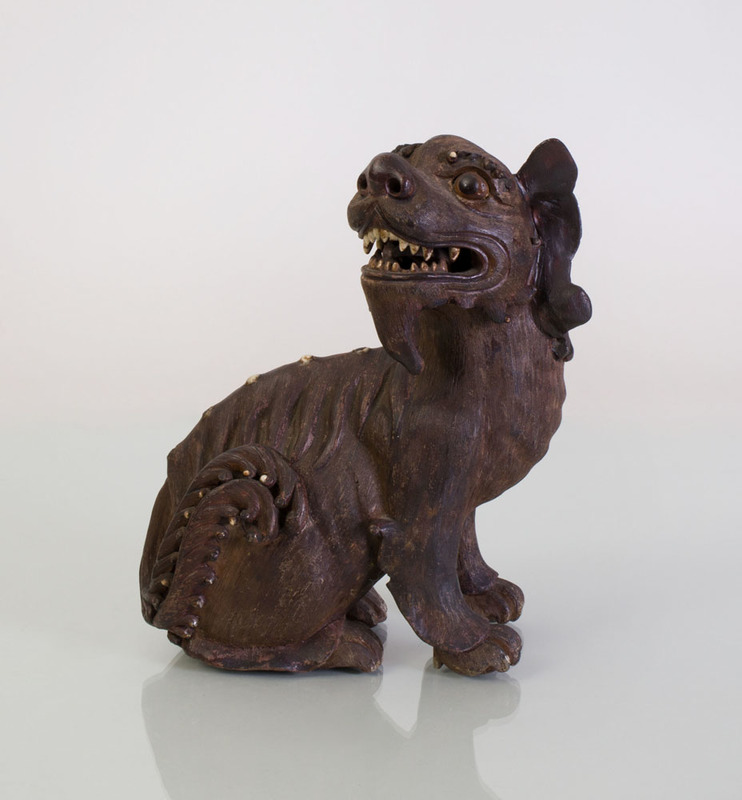 CHINESE POTTERY MODEL OF A MYTHICAL BEAST