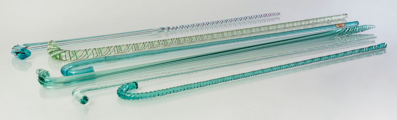 GROUP OF NINE TURQUOISE AND INTERNALLY-DECORATED GLASS CANES