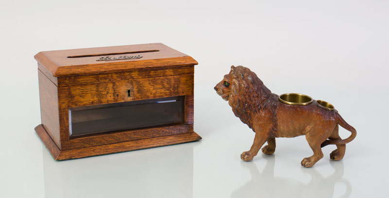 ENGLISH OAK LETTER BOX AND AN AUSTRIAN COLD-PAINTED BRONZE FIGURE OF A LION
