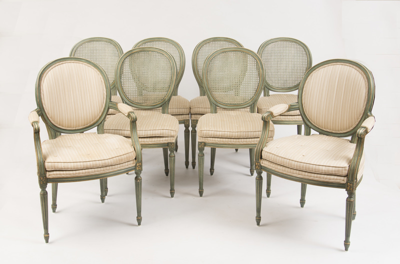 EIGHT LOUIS XVI STYLE GREEN PAINTED AND CANED DINING CHAIRS