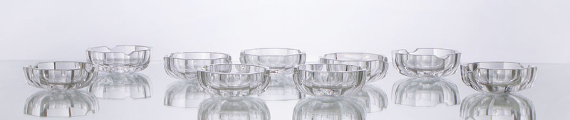 GROUP OF NINE BACCARAT GLASS VIDE POCHES