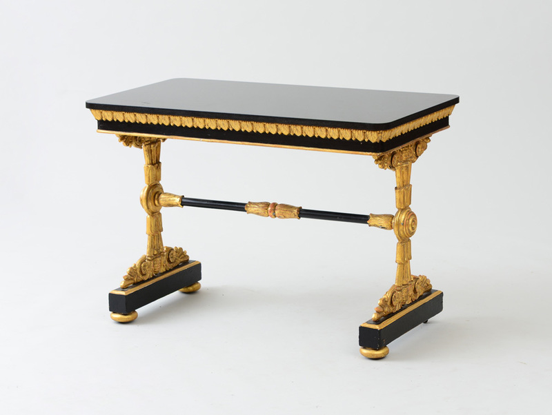 LATE WILLIAM IV EBONIZED WOOD AND PARCEL-GILT CAST-IRON LIBRARY TABLE
