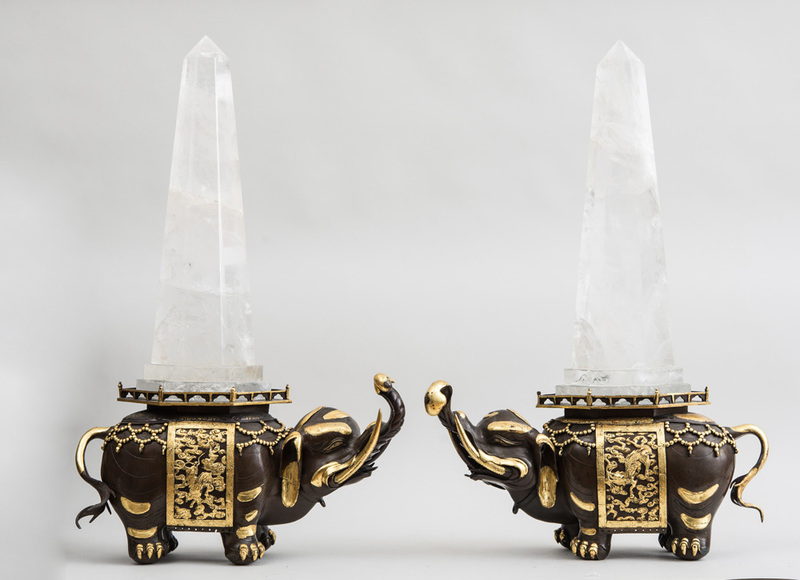 PAIR OF CHINOISERIE ROCK CRYSTAL OBELISKS ON BRONZE AND PARCEL-GILT ELEPHANT SUPPORTS
