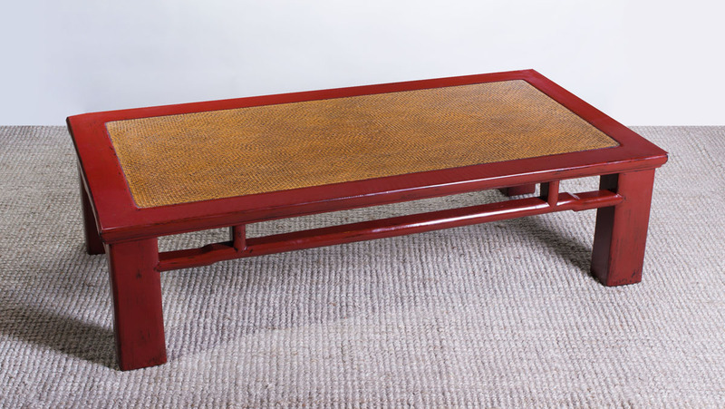 LARGE CHINESE RED LACQUER AND WICKER LOW TABLE