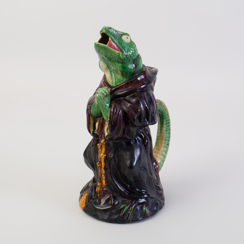 Continental Majolica Pitcher in the Form of a Praying Lizard in a Monk's Robe