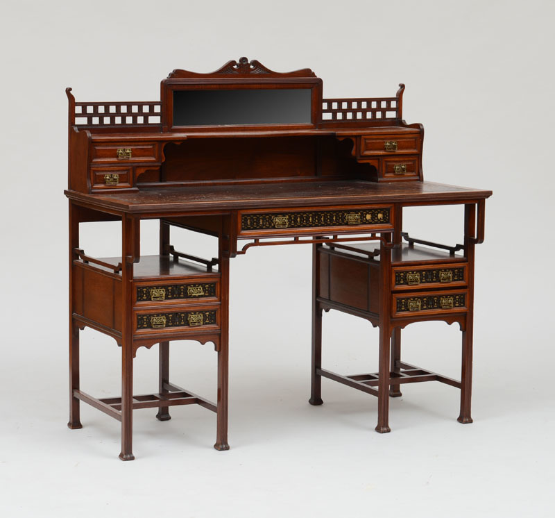English Aesthetic Movement Brass-Mounted Mahogany and Ebonized Fretwork Desk, Stamped Gillow & Co., Lancaster and London, Circa 1875