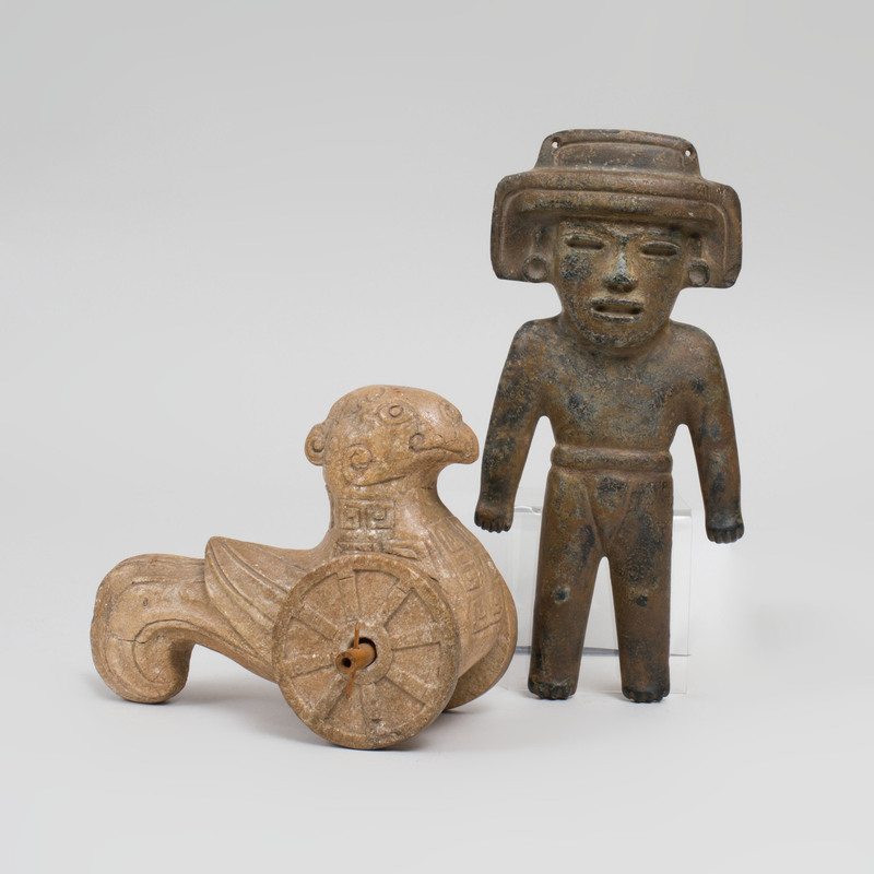 Han Style Carved Stone Figure of a Stylized Bird on Wheels