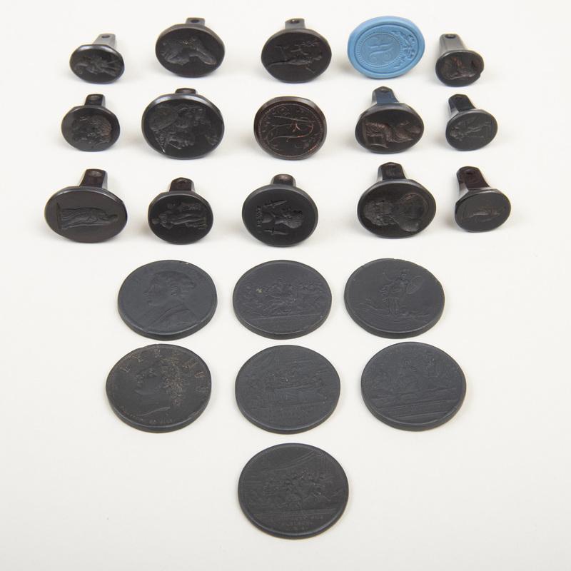 Fourteen Wedgwood Black Basalt Seals
