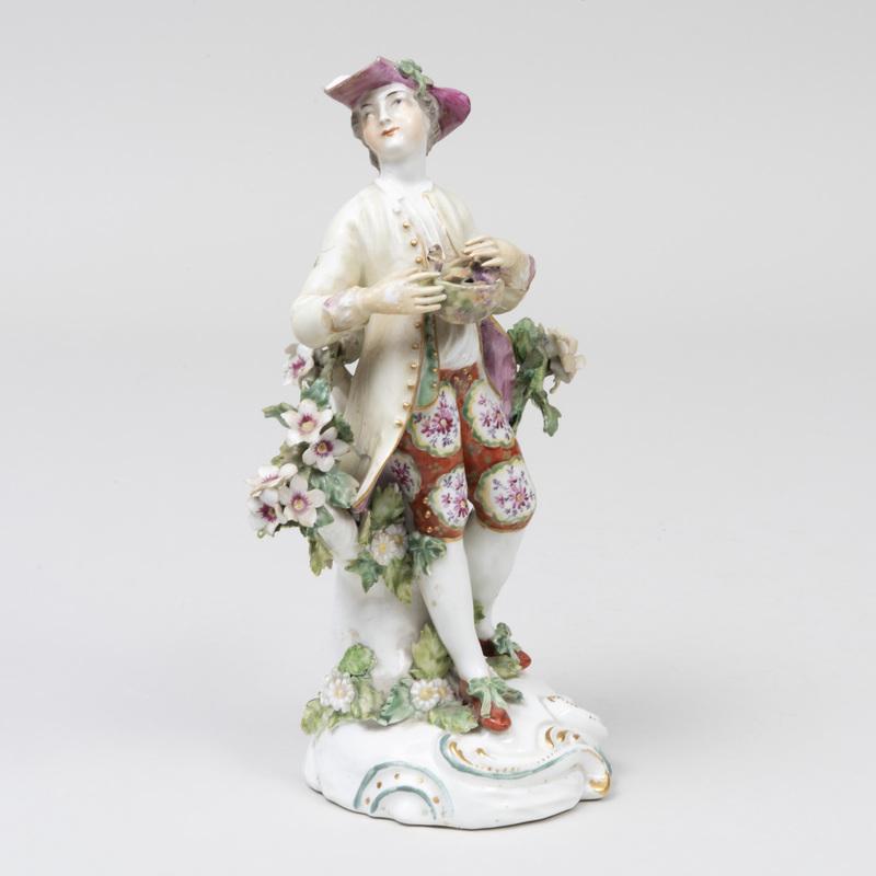 Derby Porcelain Figure of a Shepherd Holding a Bird's Nest