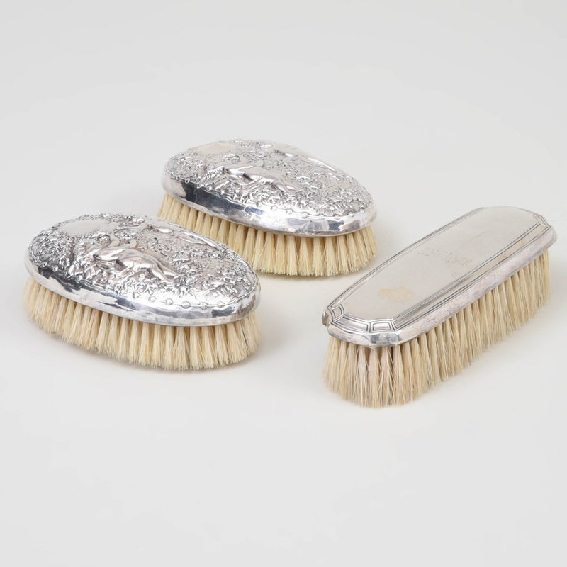 Two Gorham Silver-Mounted Clothes Brushes and a Tiffany Silver-Mounted Clothes Brush