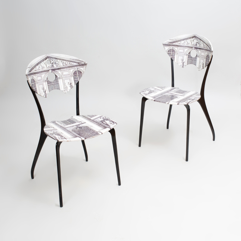 Pair of Piero Fornasetti Style Transfer Printed and Ebonized Chairs, of Recent Manufacture