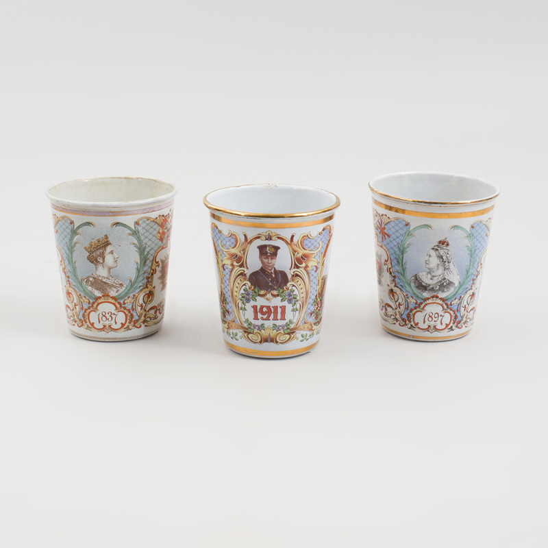 Two Enamel Queen Victoria Jubilee Beakers, and a King George V Coronation Beaker