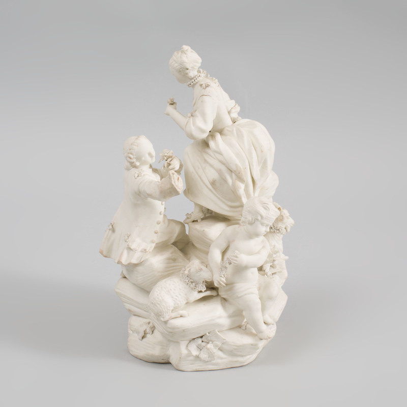 French Biscuit Porcelain Figure Group of an Amorous Couple with Two Putti, Ewe, and Goat