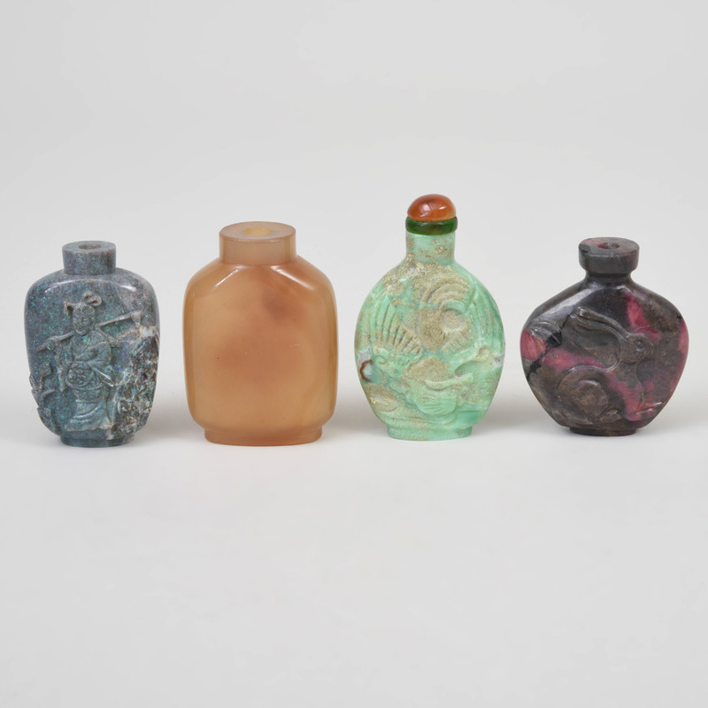 Four Chinese Carved Hardstone Snuff Bottles