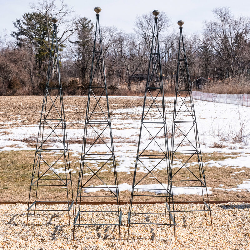 Four Green Painted Metal and Brass Garden Obelisks
