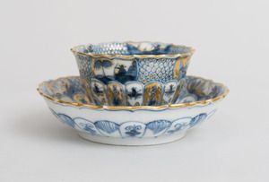 MEISSEN GILT-DECORATED BLUE AND WHITE PORCELAIN TEA BOWL AND SAUCER