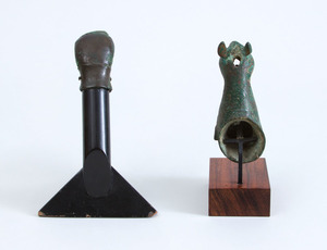 EGYPTIAN BRONZE DUCK HEAD HANDLE AND A BRONZE FIGURE OF A FELINE