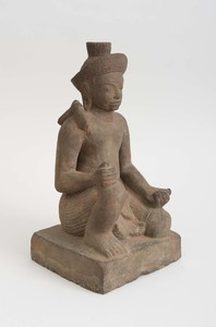 KHMER STYLE CARVED STONE ACOLYTE, 20TH CENTURY