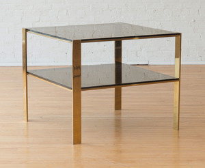 LARGE BRASS AND SMOKED GLASS END TABLE, IN THE STYLE OF BILLY BALDWIN
