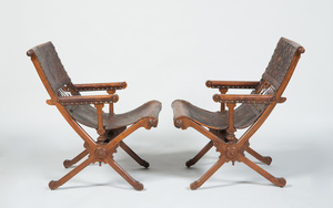PAIR OF CONTINENTAL AESTHETIC MOVEMENT CARVED WALNUT AND EMBOSSED AND GILT-LEATHER ARMCHAIRS, POSSIBLY SPANISH