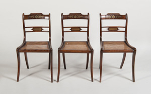 SET OF THREE REGENCY STYLE BRASS-INLAID GRAINED AND CANED SIDE CHAIRS