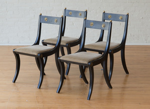 FOUR REGENCY STYLE BRASS-MOUNTED EBONIZED SIDE CHAIRS