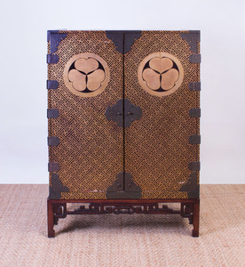 JAPANESE METAL-MOUNTED GILT AND BLACK LACQUER CABINET ON CHINESE HARDWOOD STAND