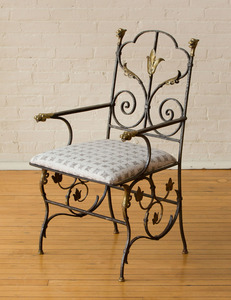 WROUGHT-IRON AND BRASS ARMCHAIR
