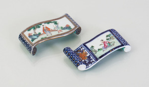 TWO SIMILAR CHINESE PORCELAIN BRUSH RESTS