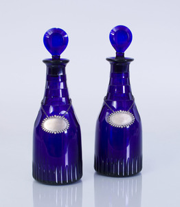 TWO ENGLISH BRISTOL BLUE GLASS DECANTERS AND STOPPERS WITH TWO AMERICAN STERLING SILVER LIQUEUR LABELS