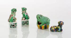 PAIR OF CHINESE GREEN, PURPLE AND YELLOW GLAZED BUDDHISTIC LIONS