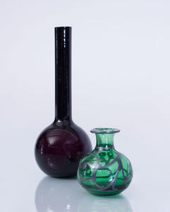 AMETHYST GLASS BUD VASE AND A GREEN GLASS VASE WITH METAL OVERLAY