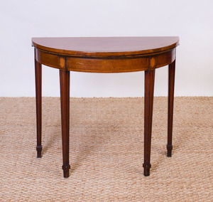 GEORGE III MAHOGANY AND SATINWOOD INLAID GAMES TABLE
