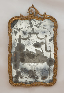 ITALIAN ROCOCO STYLE CARVED GILTWOOD, PAINTED AND INCISED GLASS MIRROR