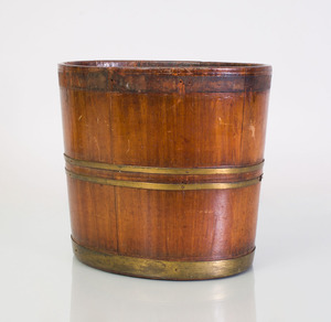 GEORGE III BRASS-BOUND-MAHOGANY OVAL PEAT BUCKET