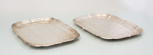 TWO CARTIER STERLING SILVER SERVING TRAYS IN THE 'WINDSOR' PATTERN
