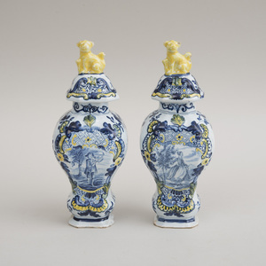 PAIR OF DUTCH POLYCHROME DELFT BALUSTER-FORM VASES AND COVERS