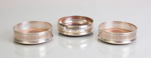THREE ENGLISH SILVER WINE COASTERS