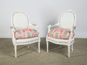 PAIR OF LOUIS XVI STYLE CARVED AND PAINTED CHAIRS