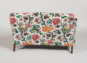 GEORGE III STYLE CARVED MAHOGANY AND COTTON-UPHOLSTERED SOFA