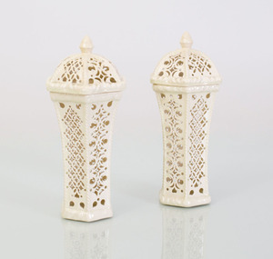 PAIR OF WEDGWOOD CREAMWARE RETICULATED HEXAGONAL BEAKER-FORM VASES AND COVERS